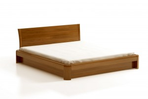 ON COMFORT bed with storage for bedding, solid oak, opening of a leg
